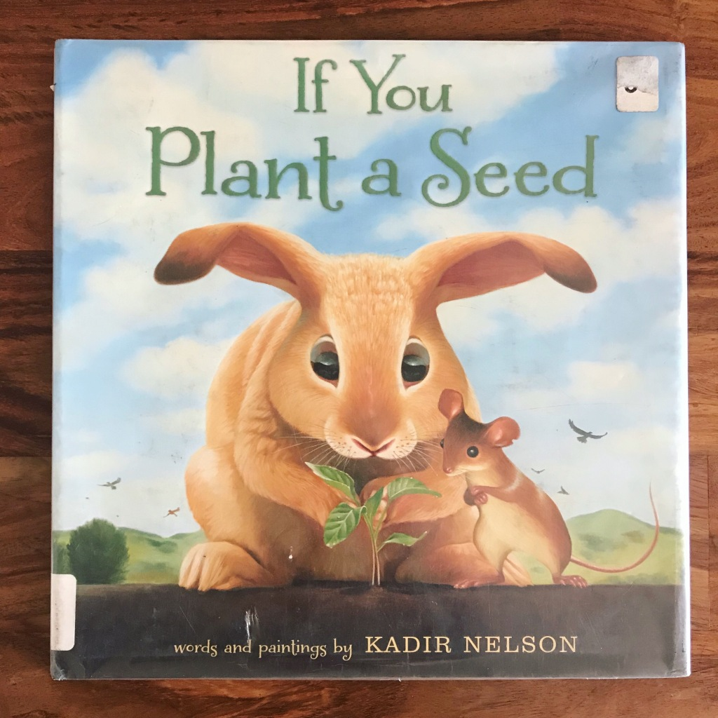 "A photo of a picture book cover. A rabbit and a mouse look intently at a small sprout coming out of the ground. The title ""If You Plant a Seed"" is written in green text at the top, and at the bottom of the cover it says ""words and paintings by Kadir Nelson."""