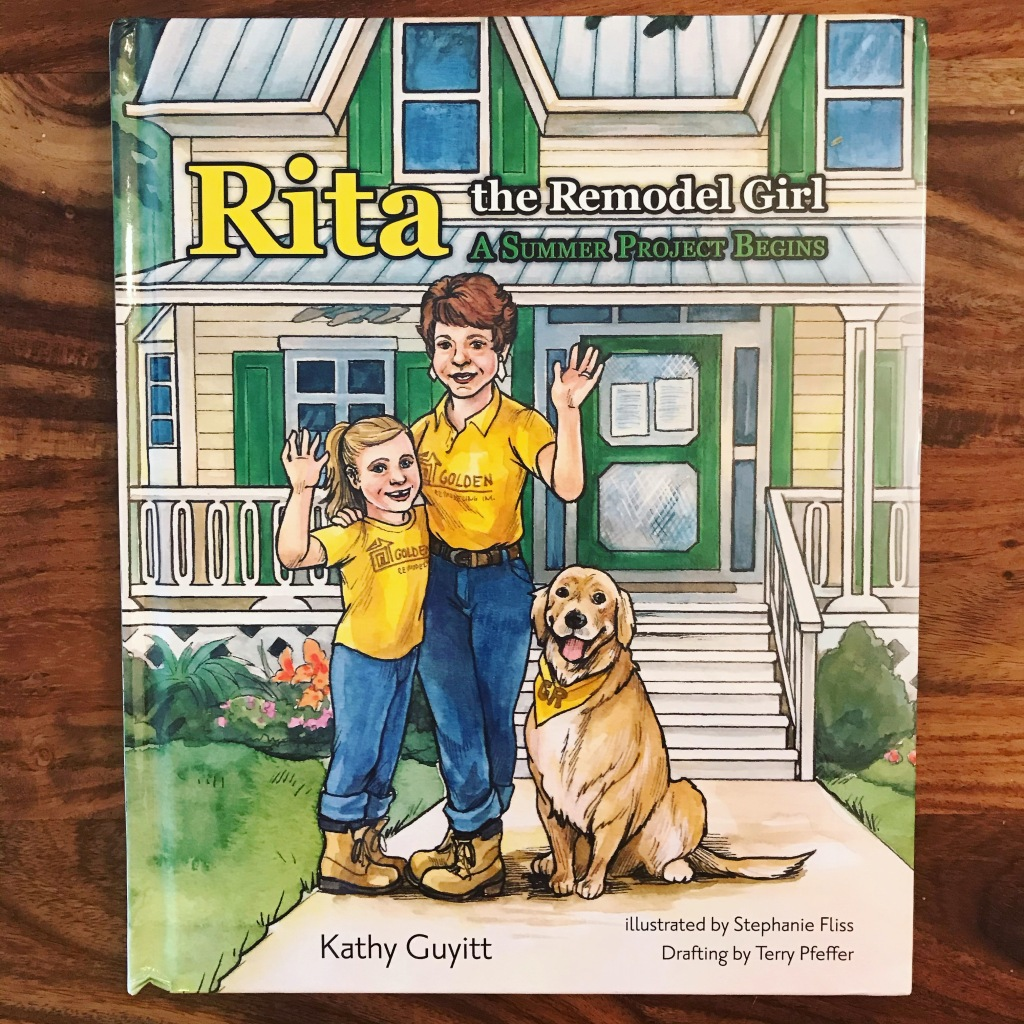 A photo of the cover of a book. The title reads Rita the Remodel Girl, A Summer Project Begins. The cover features an illustration of a girl with a blond ponytail standing with her mother, who has short brown hair. They are standing in front of a house. Both are waving and wearing a yellow shirt, jeans and work boots. Their golden retriever is sitting next to them.